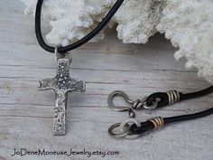 Rustic cross necklace in sterling silver on a black leather cord $65.00 by JoDeneMoneuseJewelry