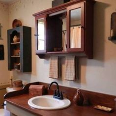 Primitive Bathroom Decor With Medicine Cabinet With Towel Bar And Wall Mounted Open Shelf Storage And Primitive Wall Sconces And Clock , Country Primitive Bathroom Decor In Bathroom Category