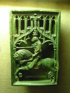 Oroszlános (talán cseh, bár nem tűnik kétfarkúnak) címeres kályhacsempe a Budapesti Történeti Múzeumban.