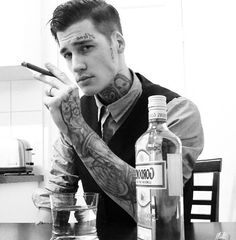 Black and white, slicked over hair, tattoos, cigar, alcohol. Sexy.