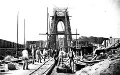 CLIFTON SUSPENSION BRIDGE, The bridge under construction. Work began on the bridge in 1836 under the supervision of Isambard Kingdom Brunel but stopped due to lack of funds. Work resumed in the and the bridge was finished in 1864 Isambard Kingdom Brunel, Bristol England, Under Construction, Bridge Construction, City Of Bristol, Bristol Uk, World Images, Suspension Bridge, Le Moulin