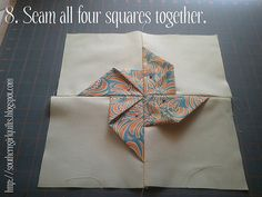 Folded fabric pinwheel quilt.