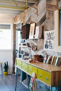 Art studio space for a writer or painter, sketch artist or illustrator. Wood on walls and floors. Open window lighting. Organized drawers.