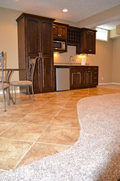 How to Finish Your Basement and Basement Remodeling Finishing your basement can almost double the square foot living space of your home. A finished basement can include new living space such as a r… Best Flooring For Basement, Basement Bar Plans, Wet Bar Basement, Basement Kitchenette, Basement Bar Designs, Basement Remodel Diy, Basement Carpet, Basement Apartment, Basement Bedrooms