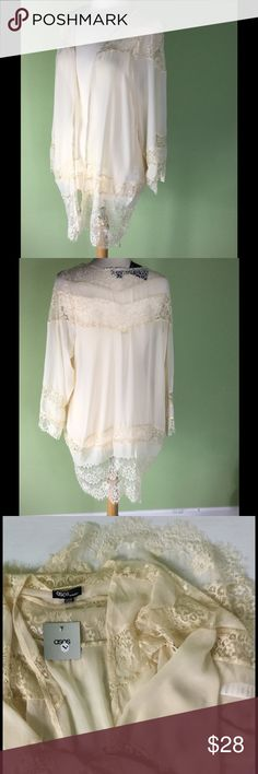 Romantic Lace Topper from ASOS. NWT. Size Lg. Beautiful cream lace topper. Wear over jeans! Size large, would fit almost everyone. Seaming at sides brings it in slightly at hip for flattering line. ASOS Sweaters Cardigans