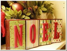 Christmas decor - so simple: painted wood blocks with scrapbook paper and glitter painted wooden letters