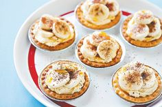 These charming pastry tarts are decorated with sliced banana and and melted chocolate.