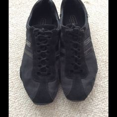 Coach Sneakers Pre-loved coach sneakers, size 10 in Black.  There is an imperfection on the side of the right shoe as shown in the last photo.  Very Comfy Coach Shoes Athletic Shoes