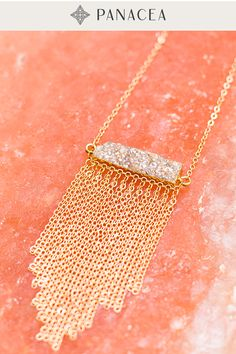 This pendant necklace features a sparkly peach druzy stone with gold chain fringe that adds the perfect amount of movement. Goes great with feminine tops and dresses.