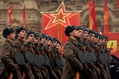 Wearing the World War II-era uniform of the Red Army troops, Russian soldiers take part in the military parade on the Red Square in Moscow on November 7, 2014.