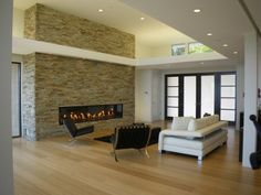 Great way to intersect a tray ceiling and fireplace.