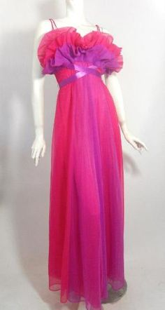 1950s shocking pink and vivid violet Vanity Fair nightgown with pale blue embroidered label. Pleated and ruffled bodice above long purple satin ribbon that criss-crosses at waist....skirt is paneled in both purple and pink. Double straps looped at shoulder. Via Dorothea's Closet Vintage.