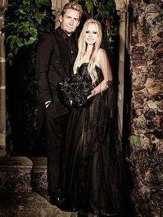 Avril Lavigne & her Gothic Wedding. Love the black dress & flowers... STUNNING