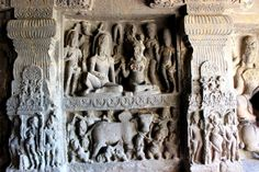 The upper part of this beautiful panel in Cave 14 represents Shiva and Parvati playing chausar, while the lower panel shows Nandi, the bull, and several of Shiva's ganas playing.