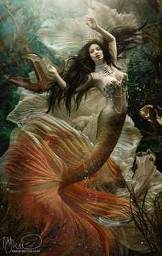 Orange tailed mermaid with anchor under the water