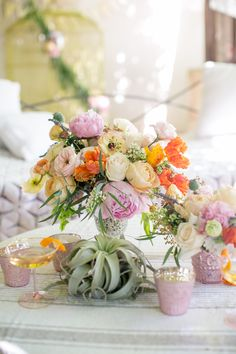 A Desert Romance bridal shower collaboration with Camille Styles and BHLDN. Flowers by Margot Blair Floral. Photography by The Nichols.  Ivory garden roses, blush peonies, and orange tulips and ranunculus make up this stunner of a centerpiece.