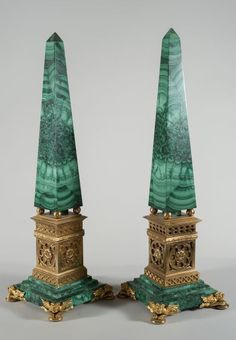 A Pair of malachite and gilded bronze obelisks with dragon shaped feet ; on square base (h 59.5 cm)