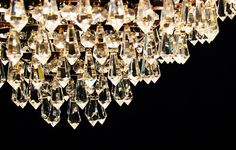 Cleaning a crystal chandelier.