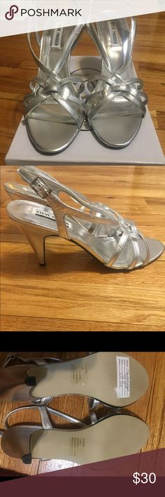 Steve Madden Sculpted Silver Leather Heels Never worn Sculpted Silver Learner Steve Madden silver Strappy heels. Perfect for any dressy occasion. Comfortable heel height, perfect for long nights or all day wedding events Steve Madden Shoes Heels