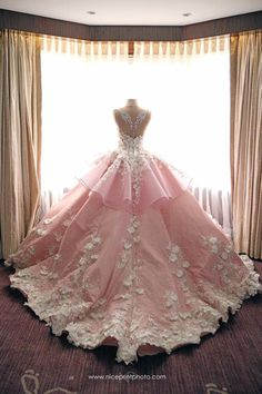Soft pink ball gown wedding dress with white embellishments // Filipino designer Mak Tumang studied interior design before delving into fashion in the Philippines. His love of opulent costumes and architecture influences his designs and this can be seen in his gowns which are rich in elaborate detail.