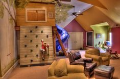 What a cool playroom! A slide to get into the room, a window, reading nook, a big fort, and a climbing wall.