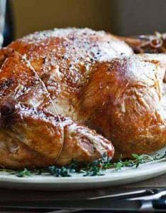 Barefoot Contessa recipe: Roast Turkey with Truffle Butter. Includes a whole head of garlic, along with onion and thyme...yuuuummm.