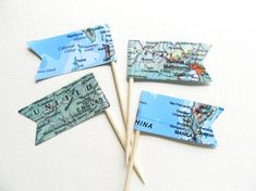 15 double-sided map pennant flag party picks, cupcake toppers  Pennants measure 1 3/4 (4.45 cm) across  Height of toothpick and pennant is 2.5 (6.35 cm)  All picks are handmade and packaged in an eco-friendly glassine bag  Made in our smoke-free/pet-free home  See all map items here: https://www.etsy.com/shop/CatchSomeRaes/search?search_query=map&order=date_desc&view_type=gallery&ref=shop_search  Need a different color or amount? Contact us, we love custom orders