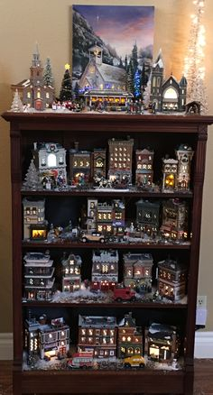 🎄 Christmas village decorations in a library ⛄ Inspiration from . Christmas Village Decorations, Christmas Tree Village, Halloween Village Display, Christmas Town, Christmas Villages, Christmas Holidays, Merry Christmas, Natal Diy, Boxing Day