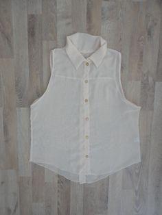 Camisa rosa sin mangas con botones dorados en frente y espalda  #ModaSustentable. Compra esta prenda en www.saveweb.com.ar!