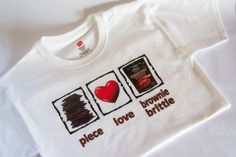 """Proudly display your love of Sheila G's Brownie Brittle snacks in this """"Piece, Love, Brownie Brittle"""" t-shirt."""