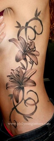 This is the one most similiar to the one I want on my right hip. I want two stargazer lilies with pink and blood orange. Side by side and not so many vines, if any vines at all. A pretty good zise, smaller than this, obviously! :)