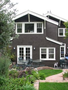 Dark cedar siding and white trim