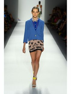 Designer Whitney Eve blue sheer blouse and black and tan skirt, blazer - Fashion Week S/S 2013 NYC.