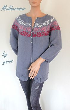 A seamless yoke cardigan with three unique rose borders. The cardigan has two lengths, both on the body and sleeves. The short cardigan goes to the waist and the sleeves are 3/4-length. The long jacket has a shaped bodice with A-line fashion and the sleeves are a bit longer as well. Lace edgings are used on the sleeves and on the body, while garter stitch edging is used on the neckband and on the front bands. The cardigan is knitted top-down and worked in the round with steeks in front.
