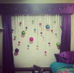 Christmas Decorations, made personally by LC. I got: $10 pack of assorted balls from dollar tree. Tied them to ribbon which was then tied to empty shower rod. Quick, easy, cute!!