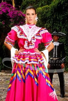 The typical dress from Jalisco is what is called an Escaramuza dress. (Escaramuza Charra is the name given to the female that participates in the sport of Charreria).  It consists of a very wide skirt that makes waves with stripes in the middle that forms a star, and more stripes at the bottom end. The blouse is made out of manta (100% cotton) with a high collar, and stripes of embroidery.