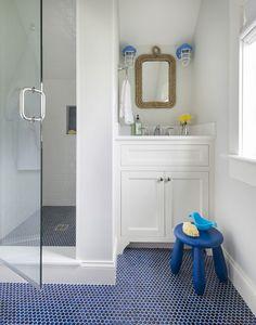 blue an dnavy penny tile floor is ideal for a nautical bathroom