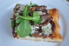 focaccia pizza with fig-onion-port jam, lamb sausage, and blue cheese