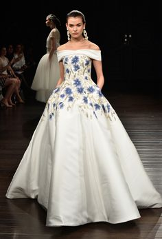 omg i wish i could pull off a dress like this! Check out these beautiful blue flowers on the Naeem Khan wedding dress, a 2017 Spring Wedding Dress trend from the NY Bridal Show!