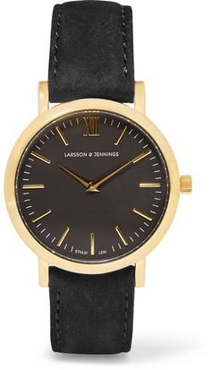 Marrying classic British design with Swedish minimalism, Larsson & Jennings' watch is smart and timeless. The gold-plated bezel houses a black dial and Swiss Quartz Movement for to-the-minute time keeping, and the strap is handcrafted from Italian-sourced suede. -- Black suede (Calf), gold-plated stainless steel- Buckle fastening- Comes in a presentation box- Made in Switzerland