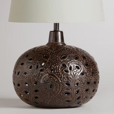 One of my favorite discoveries at WorldMarket.com: Prema Punched Metal Table Lamp Base.  Love the color and texture.