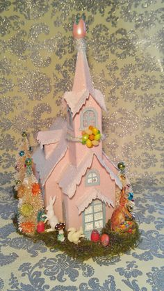 Large Vintage Spring Easter Putz House with Bottle Brush Trees Easter Bunnies and Easter Eggs. $55.00, via Etsy.