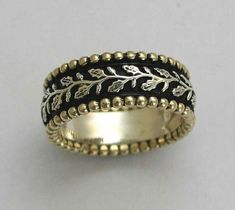 Sterling silver and yellow gold infinity ring leaves band - Open up your heart. $314.00, via Etsy.