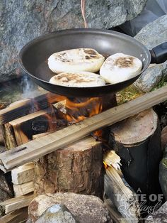 Bannocks cooking on a Nordic Fire Log