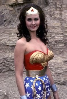 Wonder Woman! I was always told I look like her. I never saw it. I wish I had her body. I think it was just the dark hair and blue eyes.