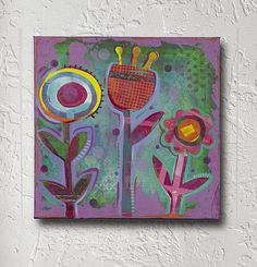 Create this project with DecoArt Media® — Funky flowers and vibrant color take center stage in this mixed media canvas.