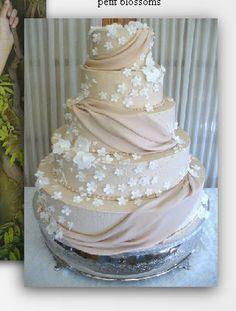 Taupe fondant drape with petit blossoms wedding cake made to match dress - stunning!