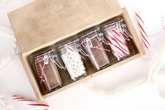 Hot chocolate hostess gift by Sugar and Cloth -- little spice jars with hot chocolate set up for two.
