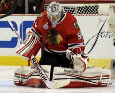 Chicago Blackhawks goalie Corey Crawford (50) makes a save during the second overtime period of Game 1 in their NHL Stanley Cup Final hockey series against...