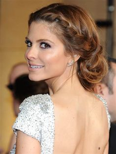 Attention brides-to-be: Hair doesn't get much more fairytale than Maria Menounos' red carpet updo. Starting with wavy, center-parted hair, create two French braids starting at your part and ending an inch below your ear. Use an elastic to bring both braids together with the rest of your hair at the nape of your neck. Tease sections of the ponytail and twirl them into a low bun.